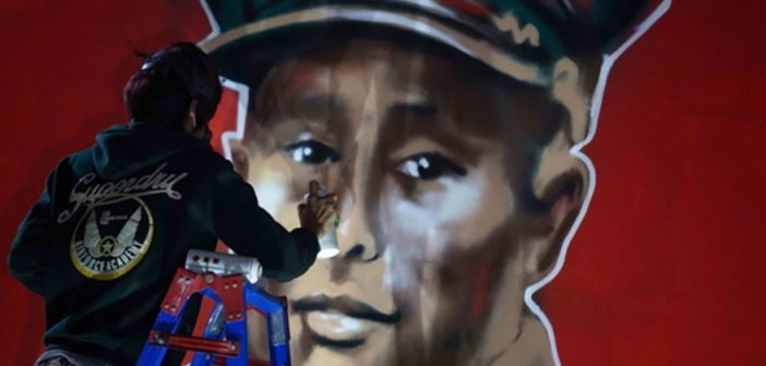 Artist Akar Kyaw spray paints a mural of General Aung San at Rangoon's Junction Square on Feb. 13, on the date of the independence icon's 100th birthday. (Photo: Thaw Hein Htet / The Irrawaddy)